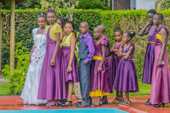 Tanzania - Arusha. Group of children dressed in purple clothing during a communial ceremony in Tanzania Royalty Free Stock Image
