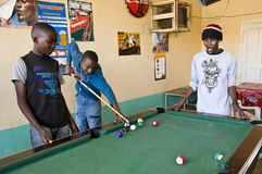 Tanzania. Arusha, local boys playing billiards in a tavern of the general market stock images