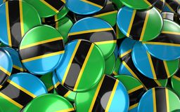 Tanzania Badges Background - Pile of Tanzania Flag Buttons. Stock Photography