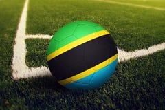 Tanzania ball on corner kick position, soccer field background. National football theme on green grass.  royalty free illustration