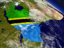 Tanzania with embedded flag on Earth Stock Images
