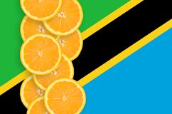 Tanzania flag and citrus fruit slices vertical row royalty free stock image