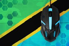 Tanzania flag and computer mouse. Concept of country representing e-sports team royalty free stock photos