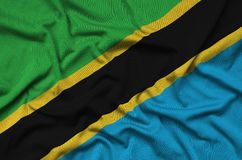 Tanzania flag is depicted on a sports cloth fabric with many folds. Sport team banner stock photography