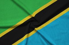 Tanzania flag is depicted on a sports cloth fabric with many folds. Sport team banner royalty free stock photo