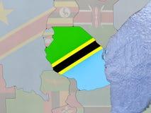 Tanzania with flag on globe Royalty Free Stock Photos