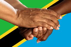 Tanzania flag, intergration of a multicultural group of young people royalty free stock photography