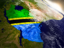 Tanzania with flag in rising sun Stock Photos