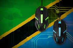 Tanzania flag and two mice with backlight. Online cooperative games. Cyber sport team stock photo