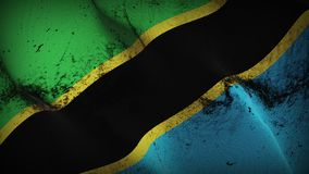 Tanzania grunge dirty flag waving on wind. Tanzanian background fullscreen grease flag blowing on wind. Realistic filth fabric texture on windy day Royalty Free Stock Photos