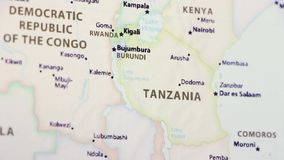 Tanzania on a Map. Tanzania on a political map of the world. Video defocuses showing and hiding the map stock footage