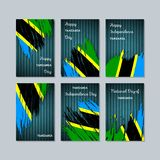 Tanzania Patriotic Cards for National Day. Expressive Brush Stroke in National Flag Colors on dark striped background. Tanzania Patriotic Vector Greeting Card Royalty Free Stock Photos