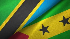 Tanzania and Sao Tome and Principe two flags textile cloth, fabric texture. Tanzania and Sao Tome and Principe two folded flags together vector illustration