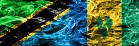 Tanzania vs Saint Vincent och Grenadinerna rökflaggor förlade sidan - vid - sidan Tjocka kulöra silkeslena rökflaggor av tanzanis vektor illustrationer
