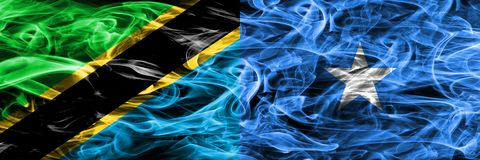 Tanzania vs Somalia, Somalian smoke flags placed side by side. Thick colored silky smoke flags of Tanzanian and Somalia, Somalian.  stock photos