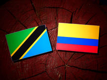 Tanzanian flag with Colombian flag on a tree stump isolated vector illustration