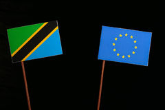 Tanzanian flag with European Union EU flag  on black Royalty Free Stock Images