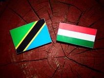 Tanzanian flag with Hungarian flag on a tree stump isolated stock illustration