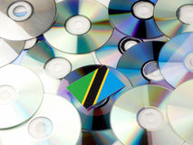 Tanzanian flag on top of CD and DVD pile isolated on white Royalty Free Stock Photos