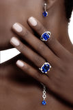 Tanzanite and Diamonds Designer Jewellery. On the Skin of a Black Lad Royalty Free Stock Images