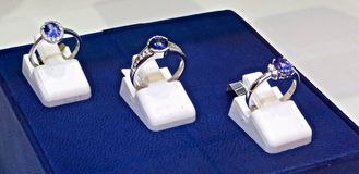 Tanzanite Rings. Three Blue tanzanite rings with diamonds on display in South Africa royalty free stock image