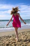 Tanzen auf den Strand Stockbild