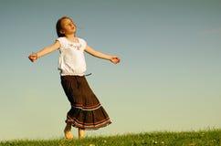 Tanzen in den Sonnenschein Stockfotos