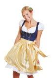 Tanzen der jungen Frau im Dirndl Lizenzfreies Stockfoto