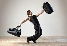 Tanzen mit Beuteln Stockfoto