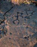 Tanzenmannpetroglyphe Stockbild
