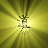 Tao character symbol light flare. Tao English and Chinese world with powerful sun light halo. Extended flares for cropping. Tao is Asian philosophy as Way or Stock Image