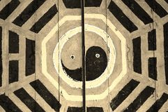 Tao symbol. Taoism symbol sculpture on old door Royalty Free Stock Images