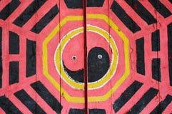 Tao symbol. Taoism symbol sculpture on old door Royalty Free Stock Photos