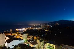 Taormina Bay and the Etna Volcano at dusk seen from Castelmola stock images