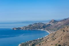 Taormina Bay in a summer day seen from Forza D`Agrò, Sicily royalty free stock photos