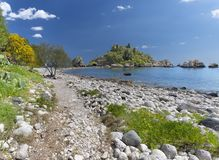 Taormina - The beautifull little island Isola Bella and the beach with the  pumice stones.  stock photos