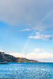 Taormina cape and rainbow in Ionian Sea in spring Royalty Free Stock Photo