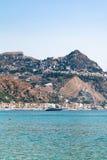 Taormina city on cape and in Giardini Naxos town. Travel to Sicily, Italy - view of Taormina city on cape and in Giardini Naxos town on coast of Ionian sea in royalty free stock photo
