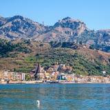 Taormina city on mountain and Giardini Naxos town. Travel to Italy - view of Taormina city on mountain and Giardini Naxos town on the coast of Ionian sea in stock image