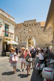 TAORMINA, ITALY - JULY, 2, 2015: Tourists walking near to the Clock Tower in Taormina, Sicily Royalty Free Stock Photo