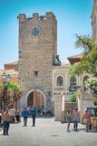 TAORMINA, ITALY - JULY, 2, 2015: Tourists walking near to the Clock Tower in Taormina, Sicily Royalty Free Stock Image