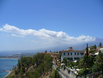 Taormina,Italy and Mt.Etna. View from Taormina,Sicily of Mt. Etna volcano with steam coming from the crater & the Mediterranean Sea along side Royalty Free Stock Photo