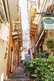 Taormina, Italy, 08/30/2016: A narrow street in the old town. royalty free stock photography