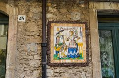 TAORMINA, ITALY - OCTOBER 2, 2017: Decorative Sicilian street tiles stock images