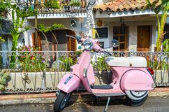 TAORMINA, ITALY - OCTOBER 1, 2017: Pink scooter in street of Taormina in Sicily stock photos