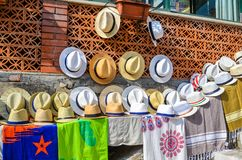 TAORMINA, ITALY - OCTOBER 1, 2017: Sun hats for sale in street royalty free stock image
