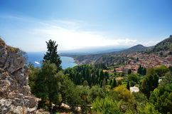 Taormina, Italy, Sicily August 26 2015. The splendid panorama from the Greek theater. Towards the sea. Lush nature, Mediterranean vegetation, flowers. Sea and stock photo