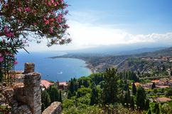 Taormina, Italy, Sicily August 26 2015. The splendid panorama from the Greek theater stock photography