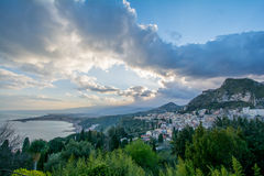 Taormina Ocean view with Etna in the Background. City of Taormina in Sicily with vulcano Etna in background stock image