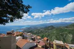 Taormina Ocean view with Etna in the Background. City of Taormina in Sicily with vulcano Etna in background royalty free stock image